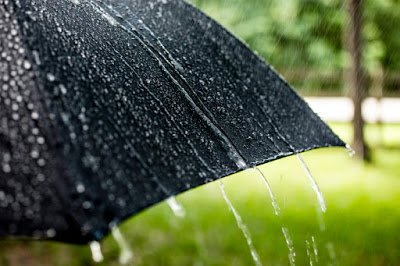 Black umbrella on a rainy day that would have followed ASTM D4112-02.