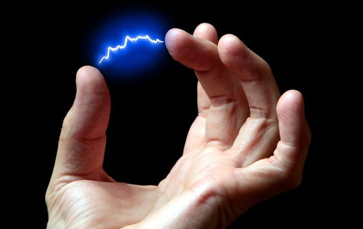 A hand with electrostatic discharge in between two fingers to display the development of an electrostatic discharge program