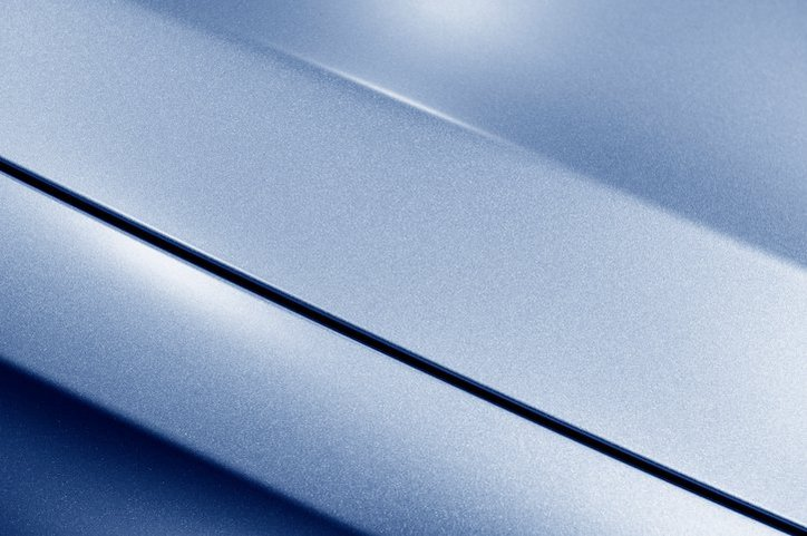 Blue adhesive coating that has been tested with ASTM D4541-17 for Pull-Off Strength.
