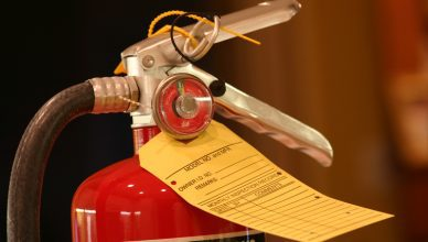 Portable fire extinguisher with tag tested to NFPA 10-2018