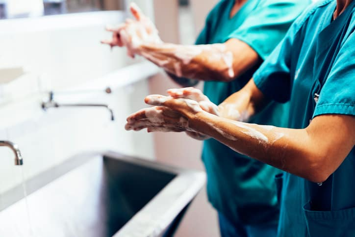 Washing hands before a surgery in compliance with the AORN Handwashing Guideline