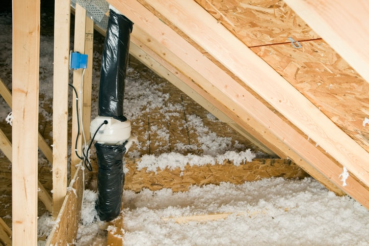 A black pipe in attic using ANSI/AARST CC-1000-2018 guidance for radon mitigation.