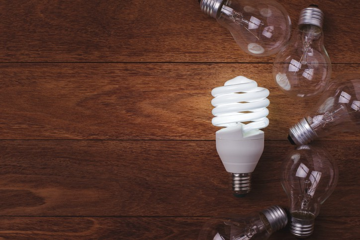 LED lightbulb shining brightly by following the ASTM E2659-18 Certificate Program Standard for accreditation and training.