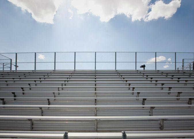 Stadium bleachers under blue sky that don't corrode thanks to ICC 300
