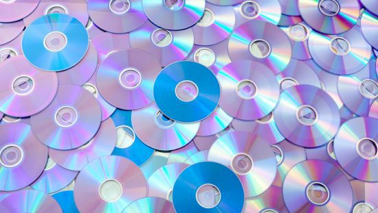 A pile of CDs that follow ISO IEC 13818