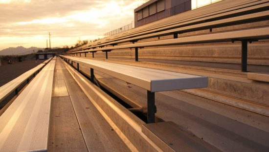 Bleachers basking in the sunset due to ICC 300-2017 compliance