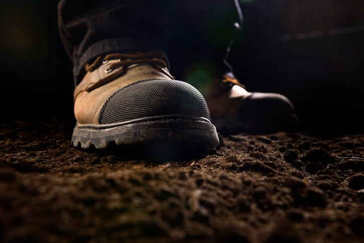 Brown boots tested to ASTM F2412-18 and staying reliable even in the darkness.