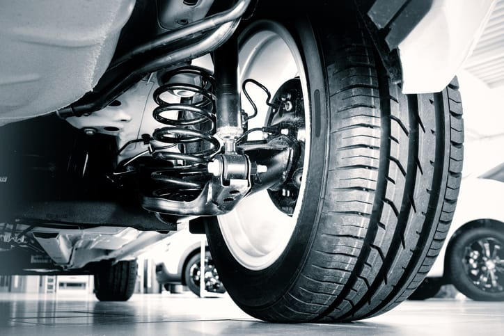 Rubber car tire in shop classified to ASTM D2000-18.