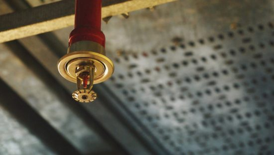 Red bright sprinkler installed with the help of NFPA 13R-2019