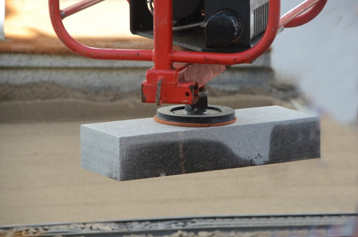Red lifter with concrete block