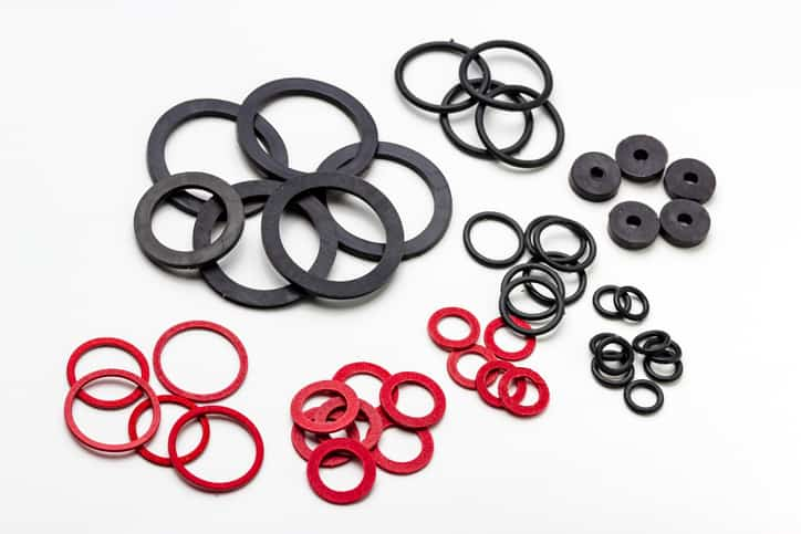 Rubber rings that have undergone testing that's defined in ASTM D395-18