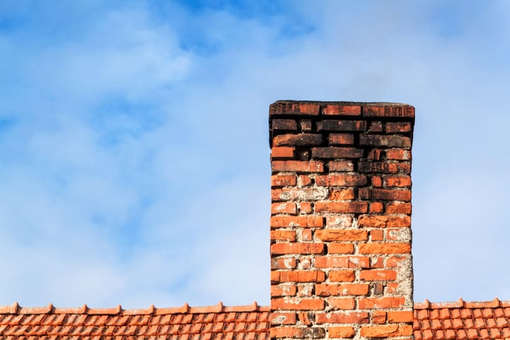 A house chimney that has seen some serious age and needs NFPA 211 2019