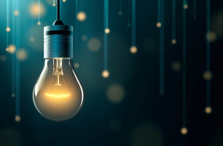Yellow lightbulb driving innovation and ISO 56002:2019 Management Systems