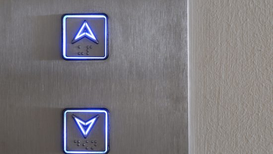 Up and down buttons of an elevator stay alight with ASME A15.5-2019 for electrical equipment.