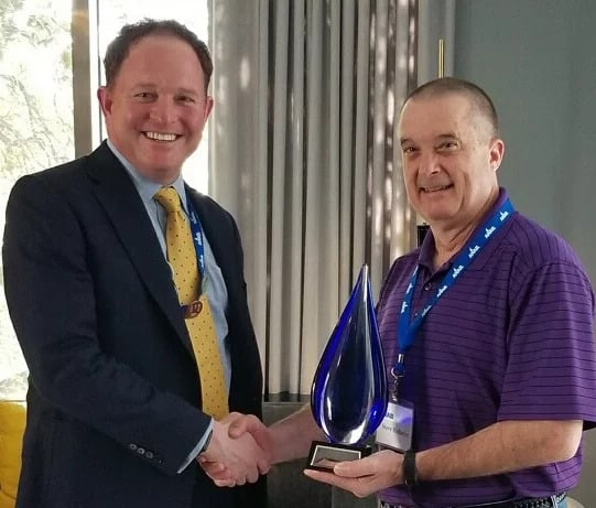 Keath Greenway gives Steve Holiday the first ANAB Assessor of the Year award.