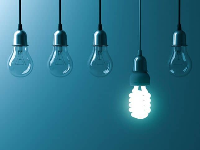 Bright bulb represents the ISO 50001:2018 energy management standard.