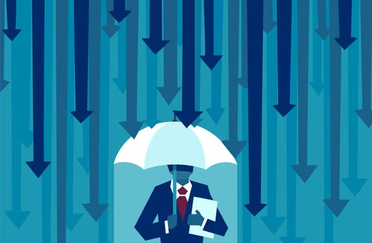 Man with an umbrella that is shielding him from the downpour of arrows to represent IEC 31010:2019