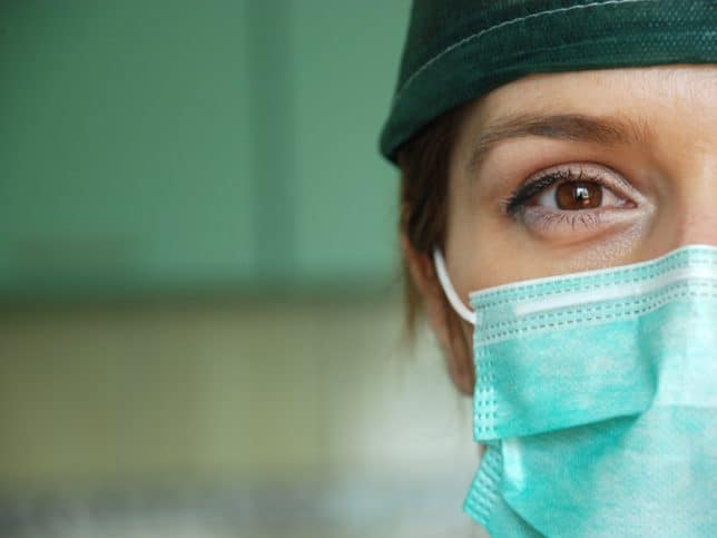 Woman wearing a medical face mask designed to ASTM F2100-19