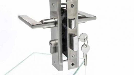 Chrome mortise lock designed to ANSI/BHMA A156.13-2017 with a key in the latch