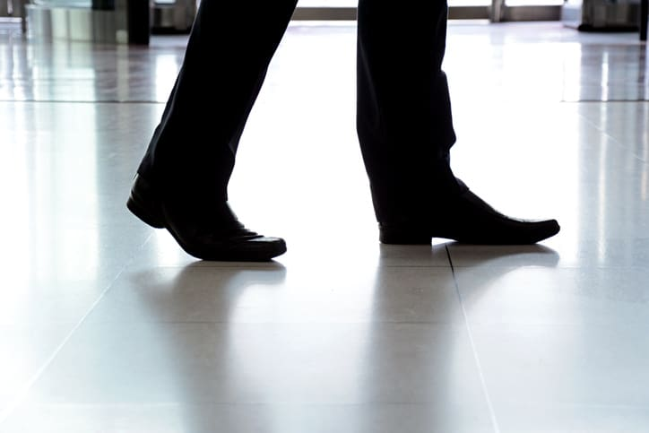 Businessman walking on NSFI safe floor.