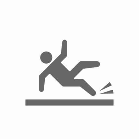 Black and white person vector slipping to indicate the importance of NSFI standards for preventing slips, trips, and falls.