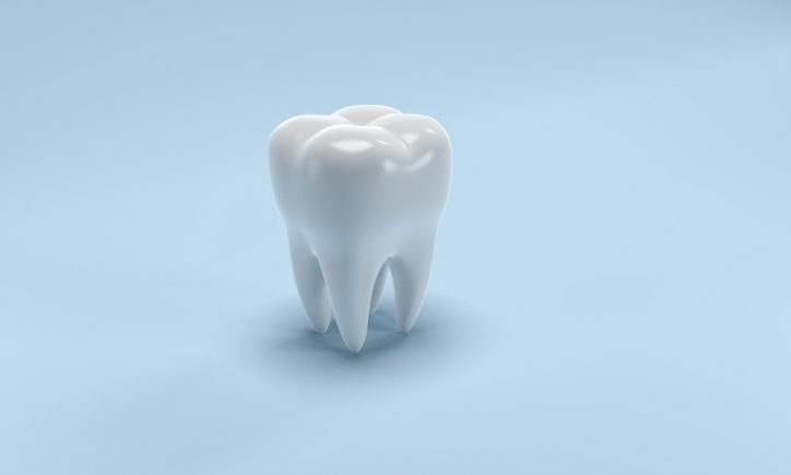 Visualized bright tooth on blue background with no adhesion problems thanks to ANSI/ADA 111-2019 testing