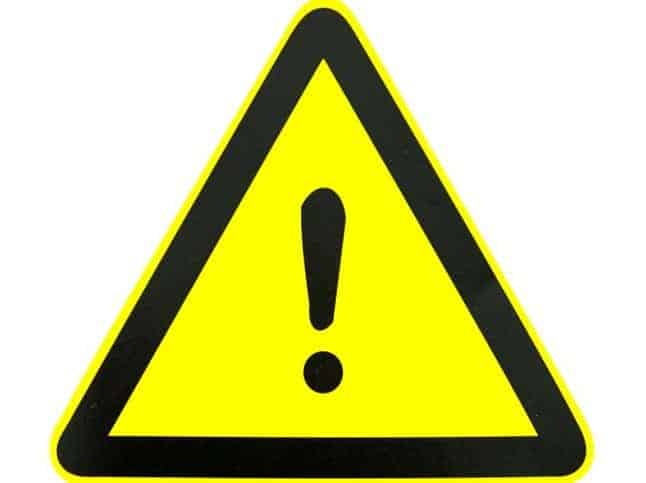 A yellow warning sign displayed on products through ANSI Z535.