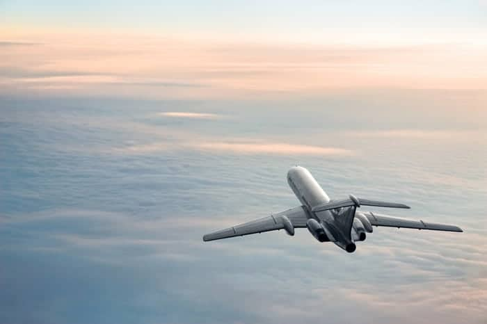 A sunrise plane journey moves smoothly above the clouds thanks to AS 9100 Series Standards.