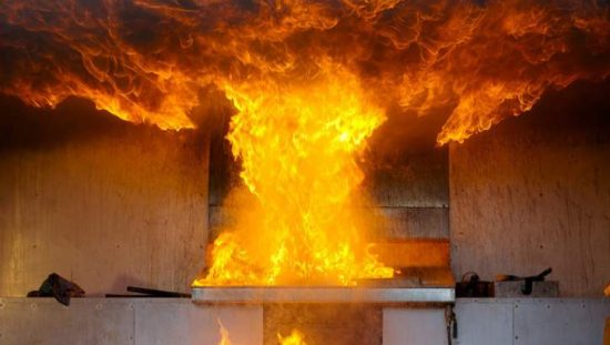 A burst of flame in a kitchen would be uncovered through NFPA 921 fire investigations.