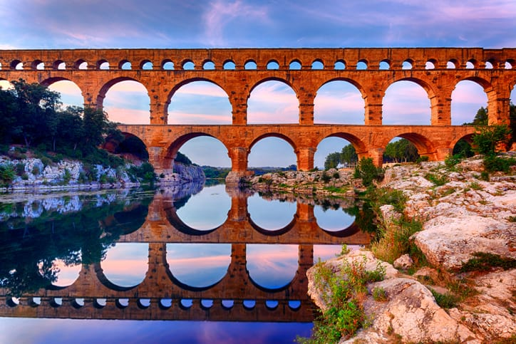 Colorful photo of Pont du Gard, a Roman aqueduct that transferred drinking water using lead.
