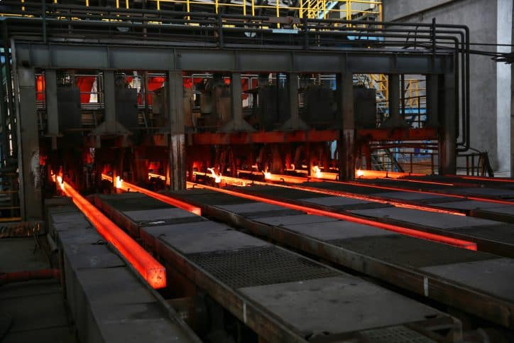 Red molten steel oozing and measured by AMS 2750F-2020 pyrometry specifications through ISO/IEC 17025 accreditation.