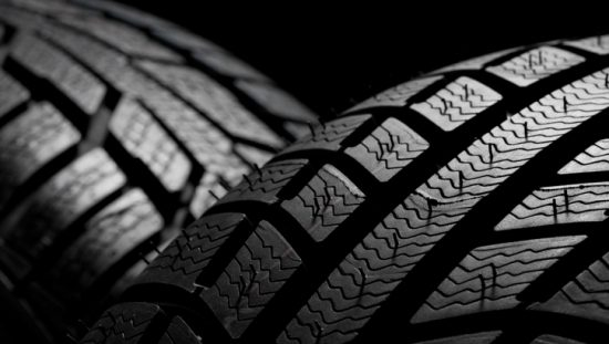 Two car tires with tread and colored black due to carbon black.