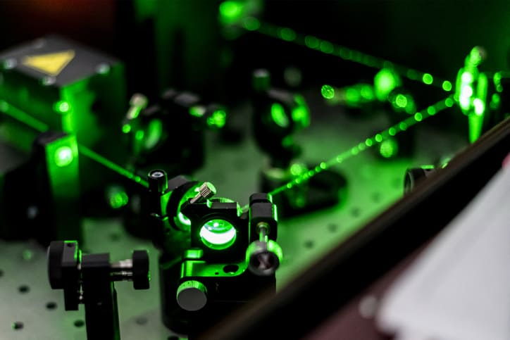 Green lasers emitted on circuit board in compliance with ANSI Z136 manufacturing and industry applications.