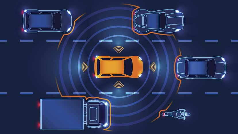 Orange car operating at Level 1 of the SAE levels of driving automation
