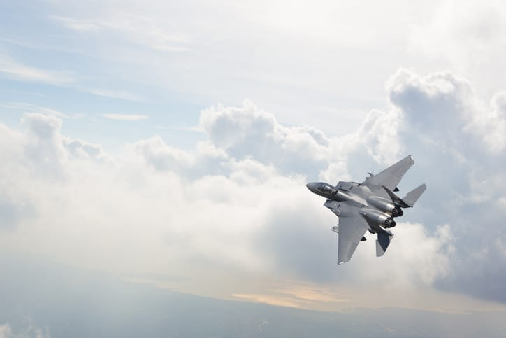 Fighter jet that was constructed with additive manufacturing flying above the clouds.