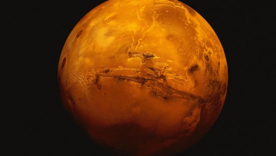 Mars red planet with surrounding black space, on which 3D printing will one day thrive.