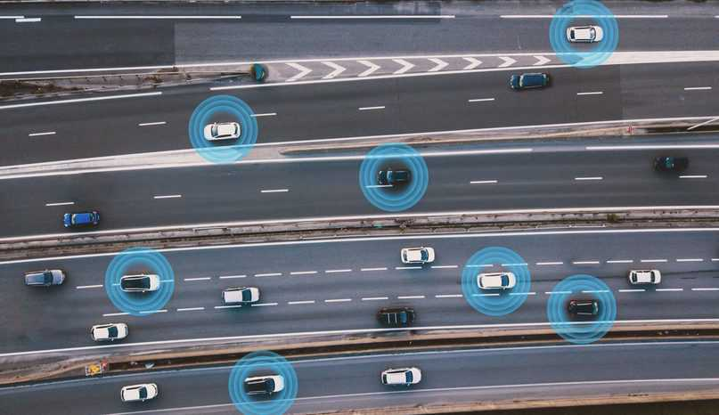 Cars on highway depending on automated driving systems outlined in SAE J 3016-2021.