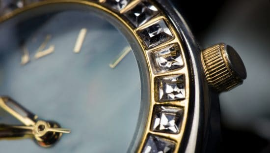 A gold rolex with IEC 60086-3:2021 watch batteries properly fitting inside under standard conditions.